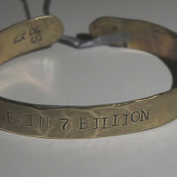 One in 7 billion brass bracelet