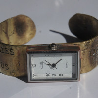 Time's Shadow brass watch closeup