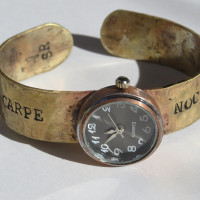 Carpe Noctem brass watch closeup