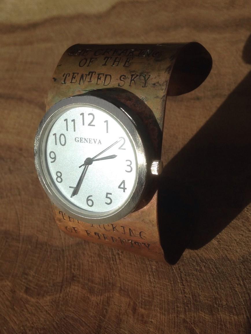 Edna St. Vincent Millay brass watch closeup