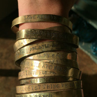 Stacked Brass Bracelets on arm