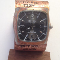 Black face tank watch on copper cuff